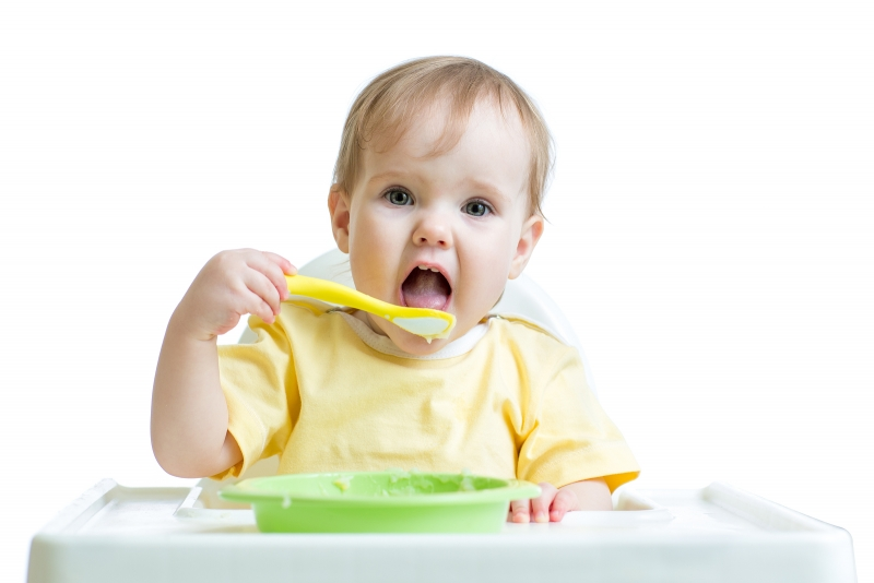 bigstock_baby_child_eating_healthy_food_80632136__1534921910_69029